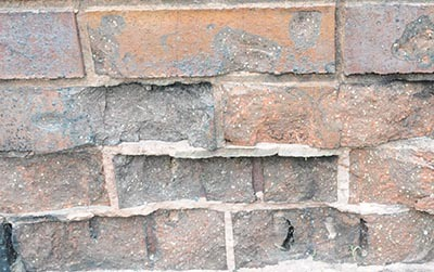 Spalling of a brick masonry wall caused by fire